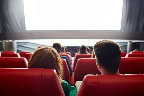 Happy Couple Watching Movie In Theater Or Cinema Stock